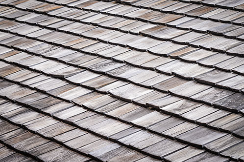 damaged roof shingles image